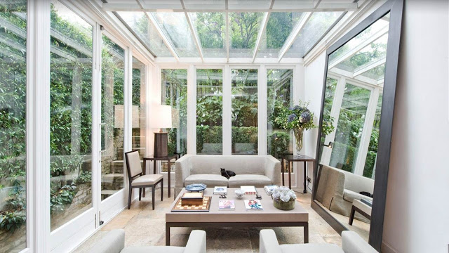 london home glass ceiling sun room living room glass walls large floor mirror modern cococozy